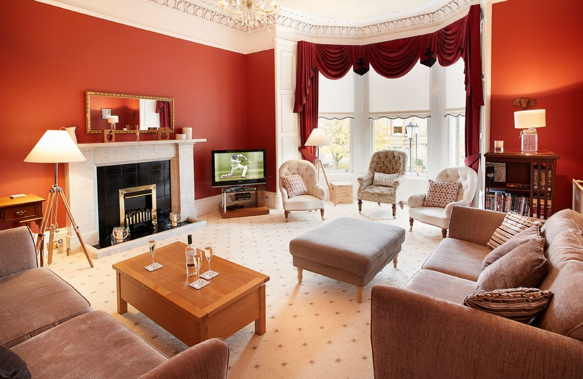 First floor: Comfortable sitting room with bay window