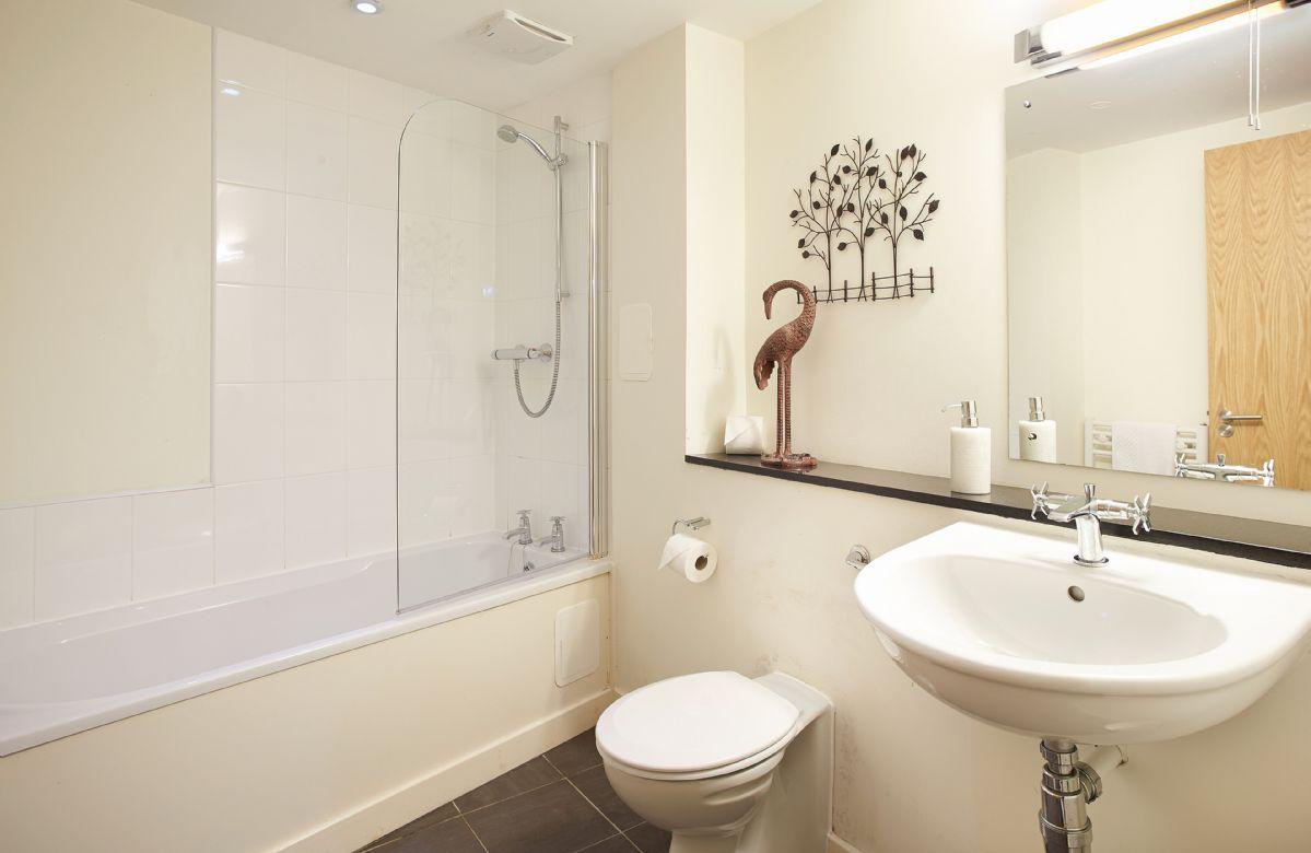 Ground floor:  Family bathroom with bath and shower over the bath