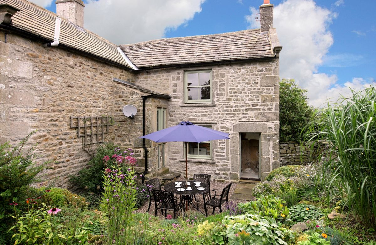 Outdoors there is a large walled fully enclosed lawned garden to the side, a rockery garden and a patio area off the kitchen (in all around 3/4 acre)
