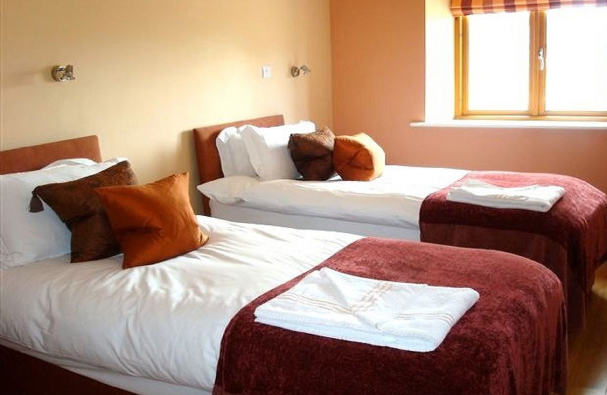 First floor:  Double bedroom with zip and link bed which can convert to twins on request