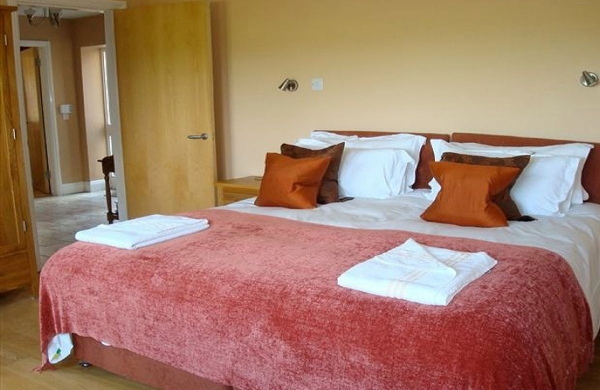 First floor: Double bedroom with zip and link bed and views over the countryside