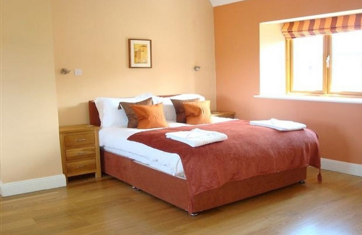 First floor: Triple bedroom with a king size and single bed