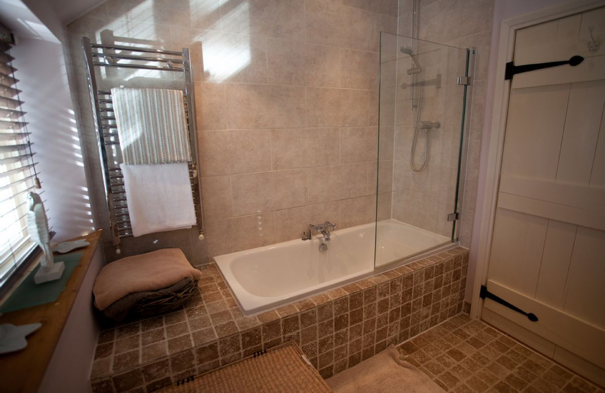 First floor: Family bathroom with a bath, twin basins, wc and overhead shower attachment