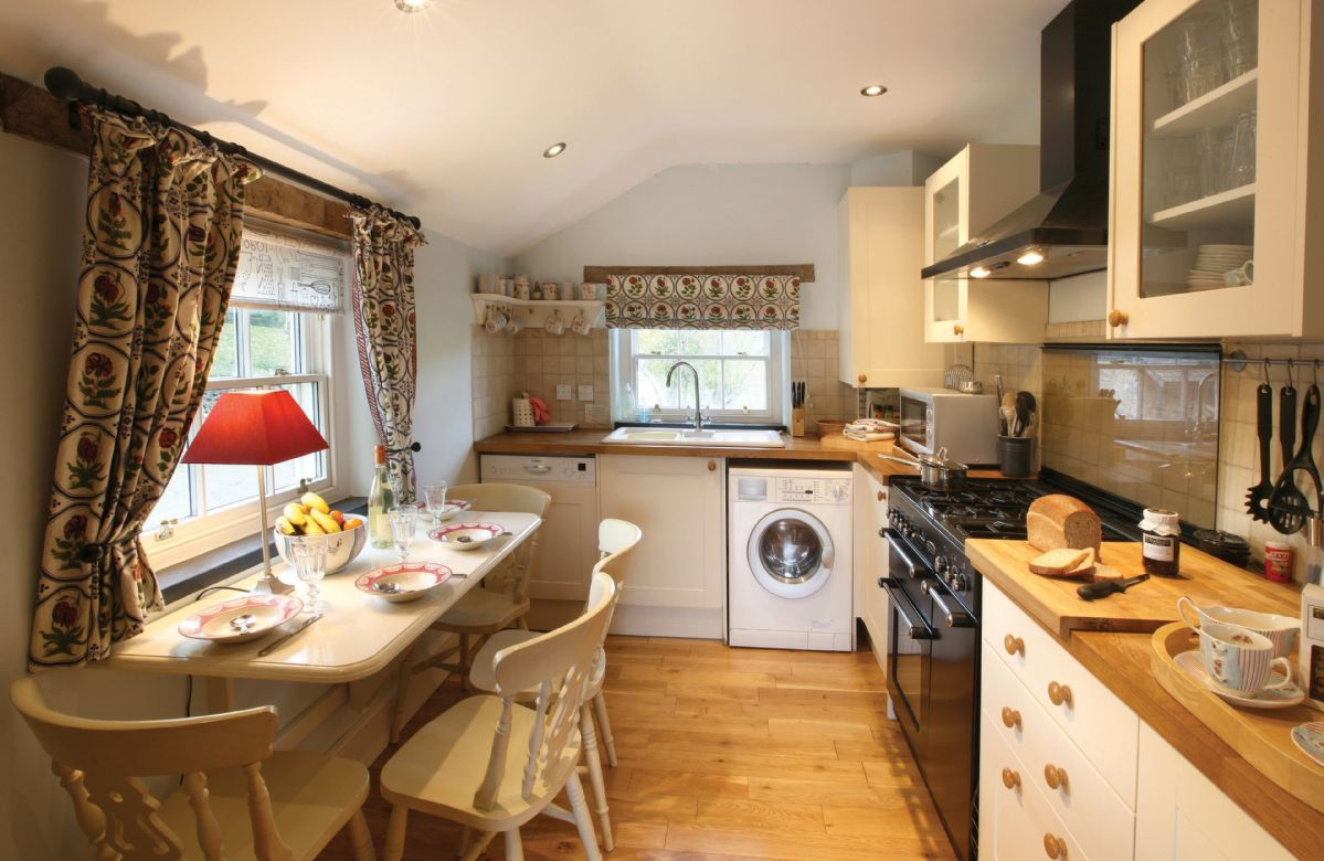 Ground floor:  Kitchen with range cooker and small breakfast table