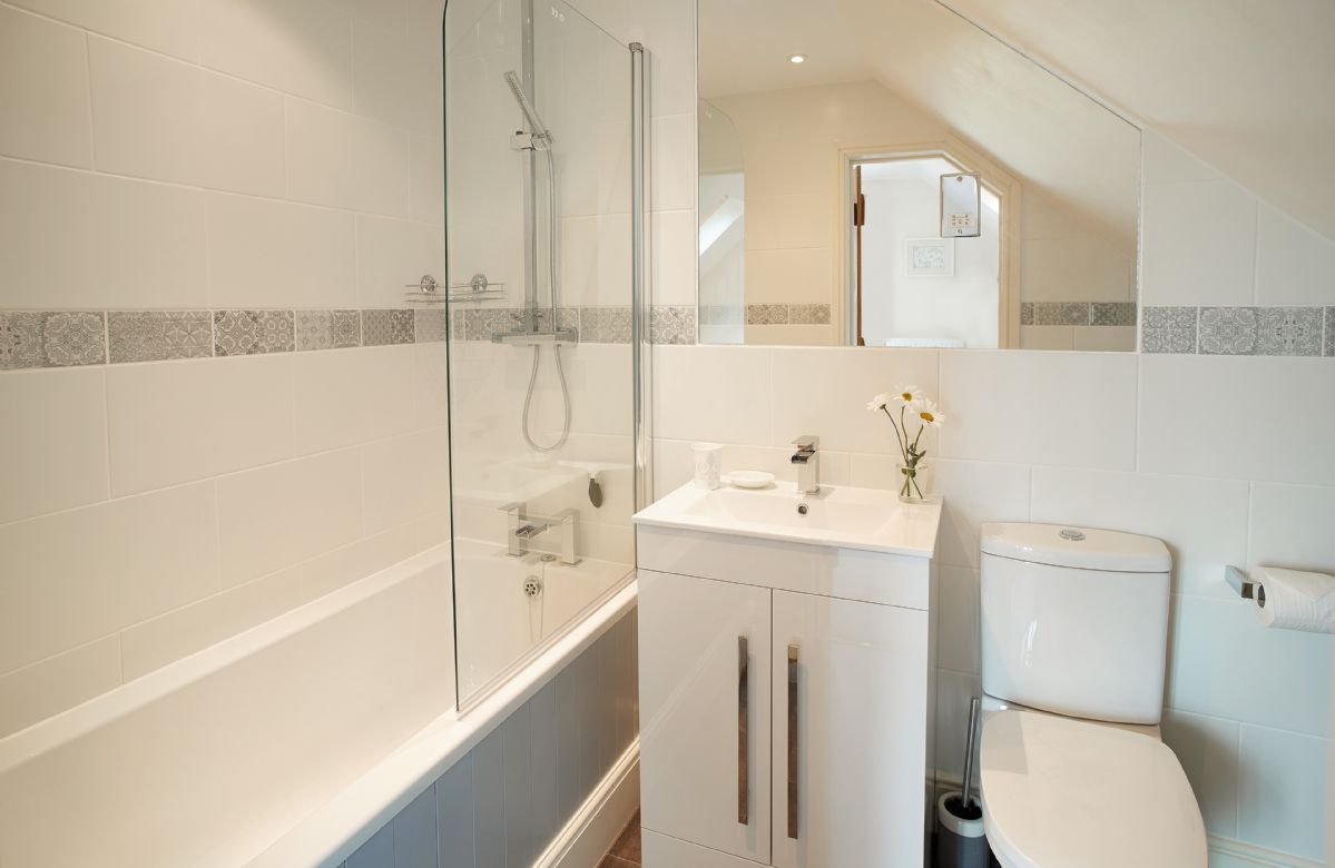 First floor: En-suite bathroom with shower over