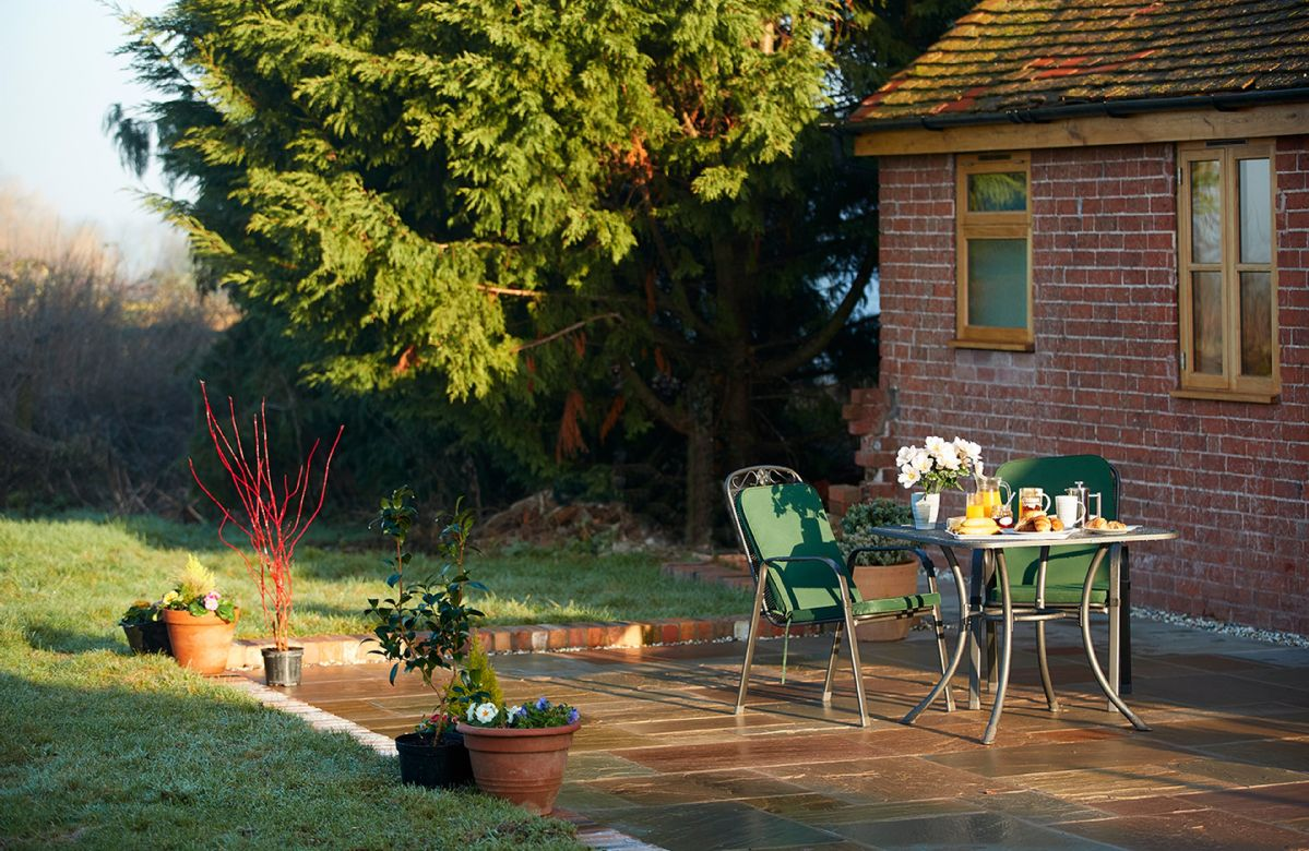 The patio and outdoor seating area is perfect for barbeques