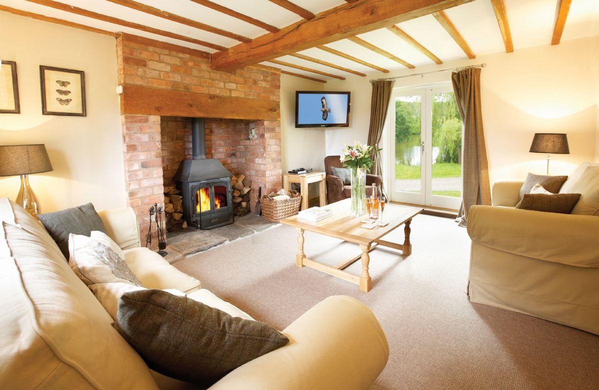 Ground floor:  Large sitting room wood burning stove and French windows which open onto the front garden