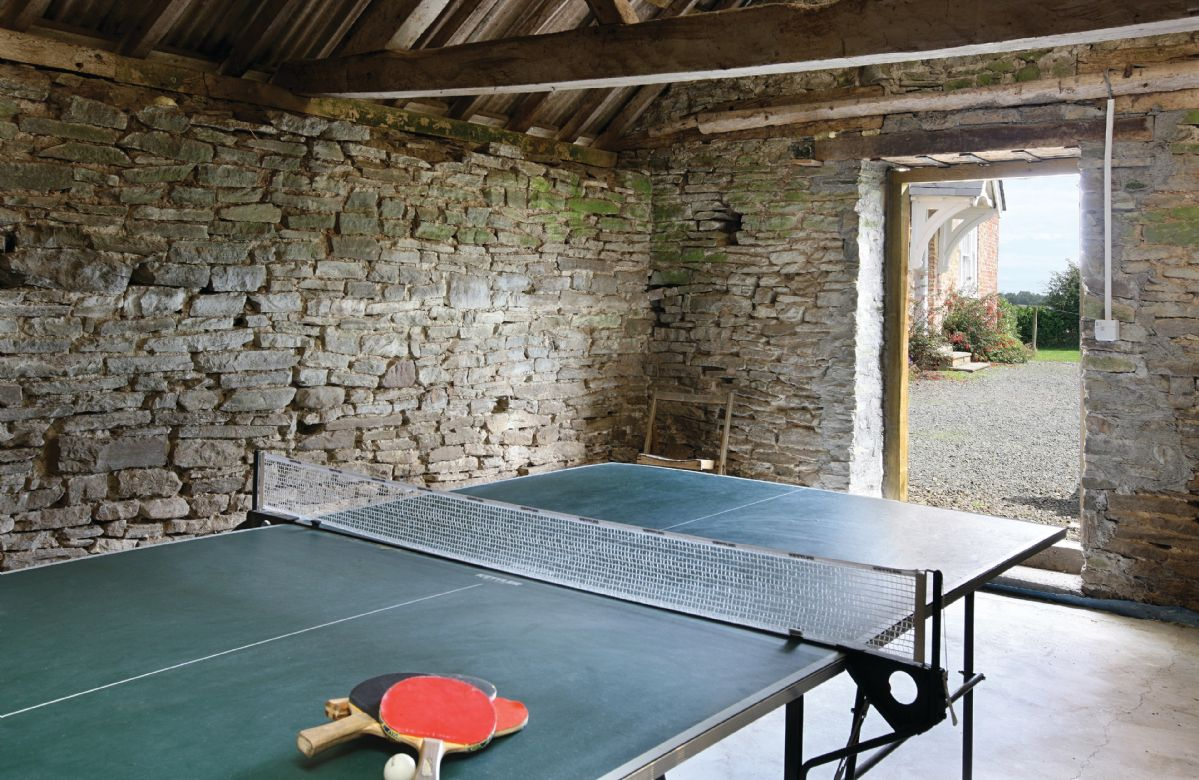Covered tennis court and table tennis in redundant farm buildings