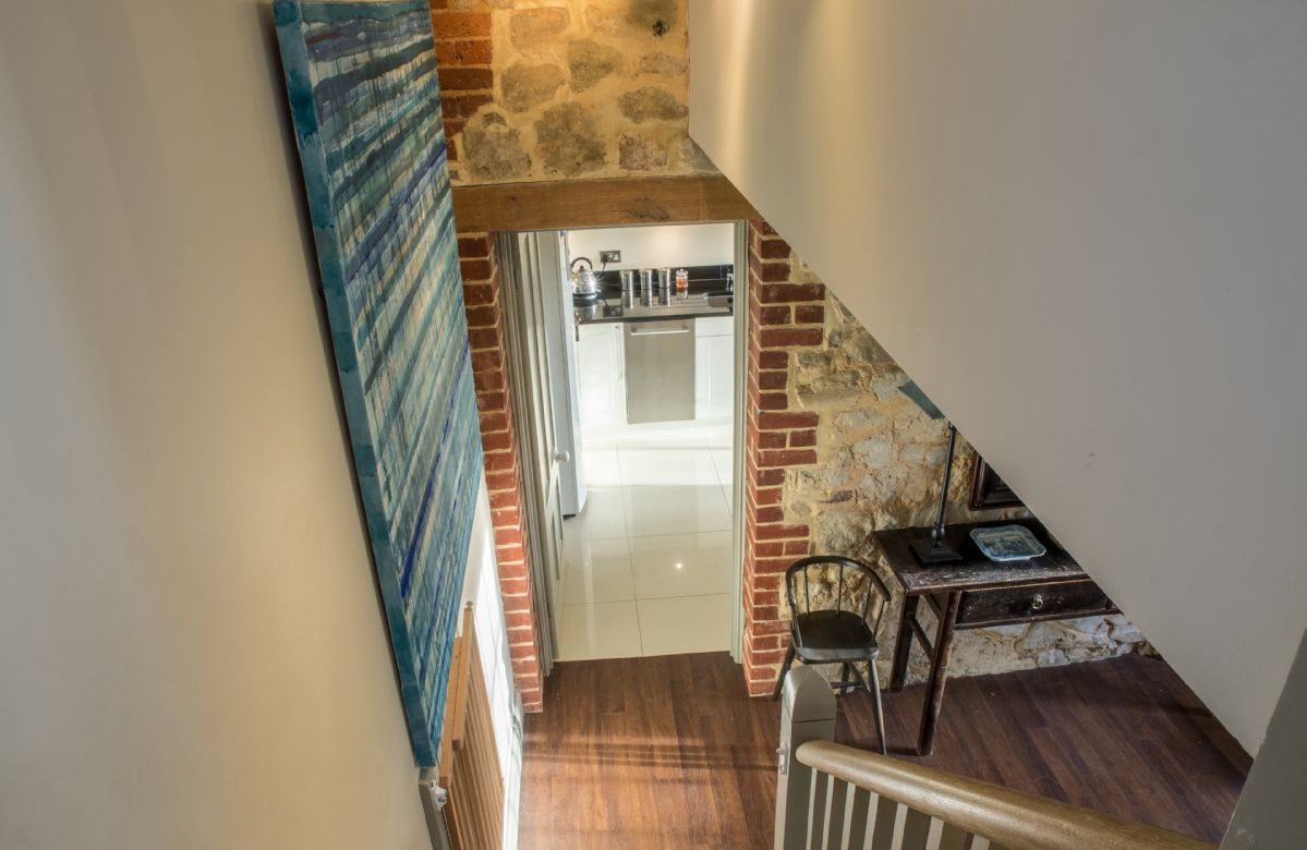 First floor: Winding staircase leading to the twin bedroom