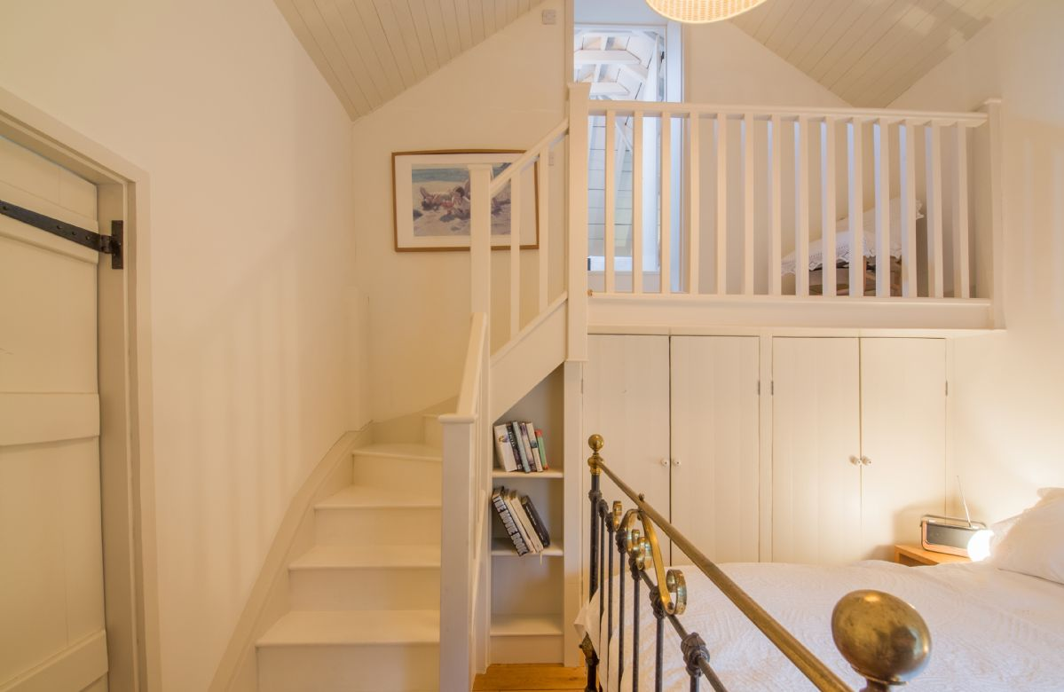 Ground floor: A wooden staircase in the master bedroom leads to the mezzanine bathroom