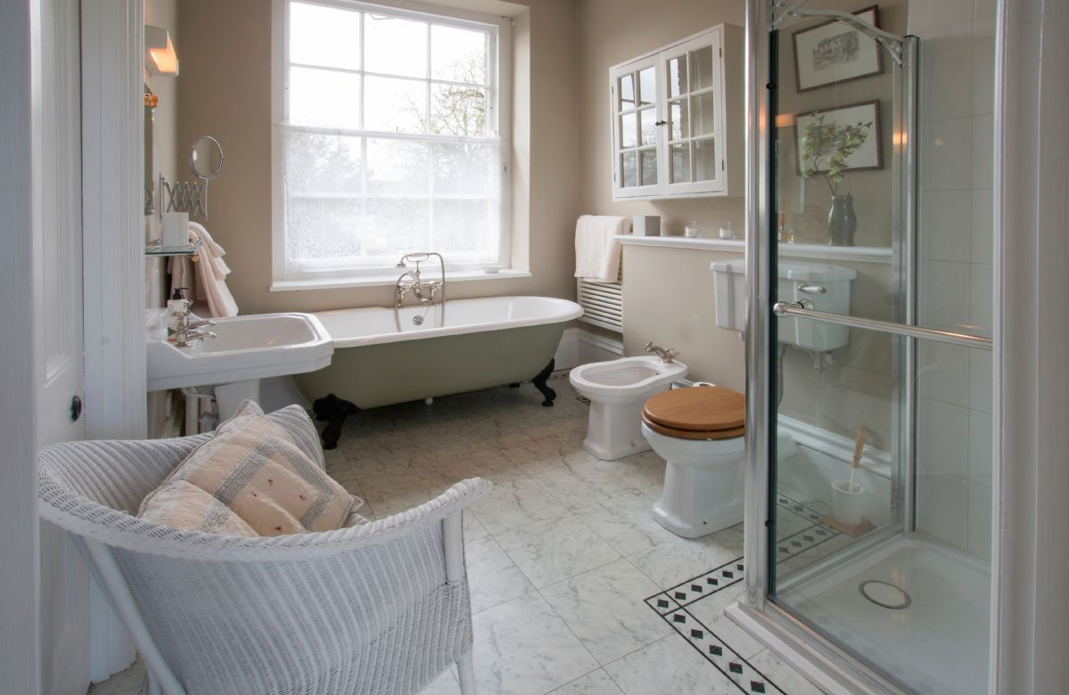 First floor: En-suite bathroom with cast iron free-standing bath and enclosed shower unit