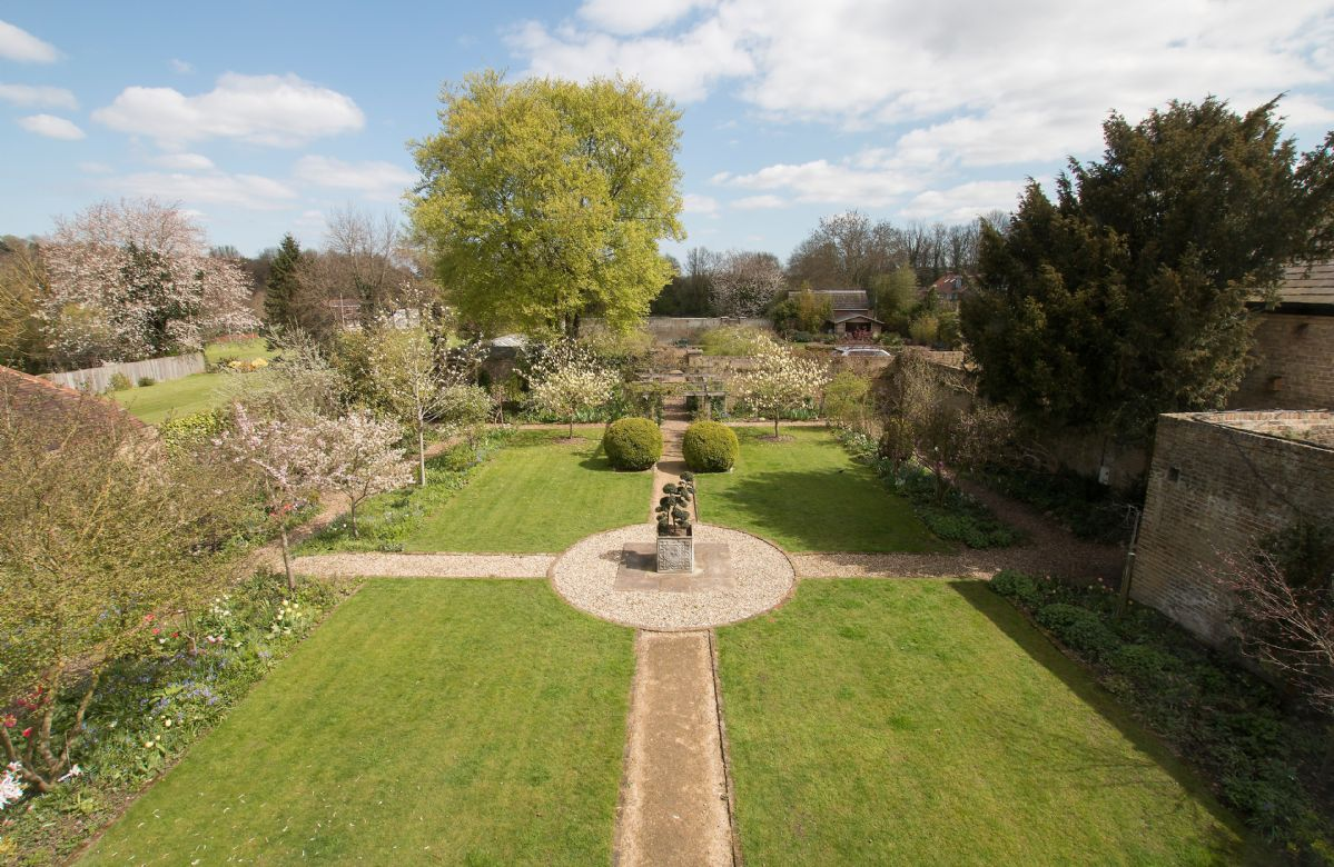 Large enclosed rear garden taken from the air