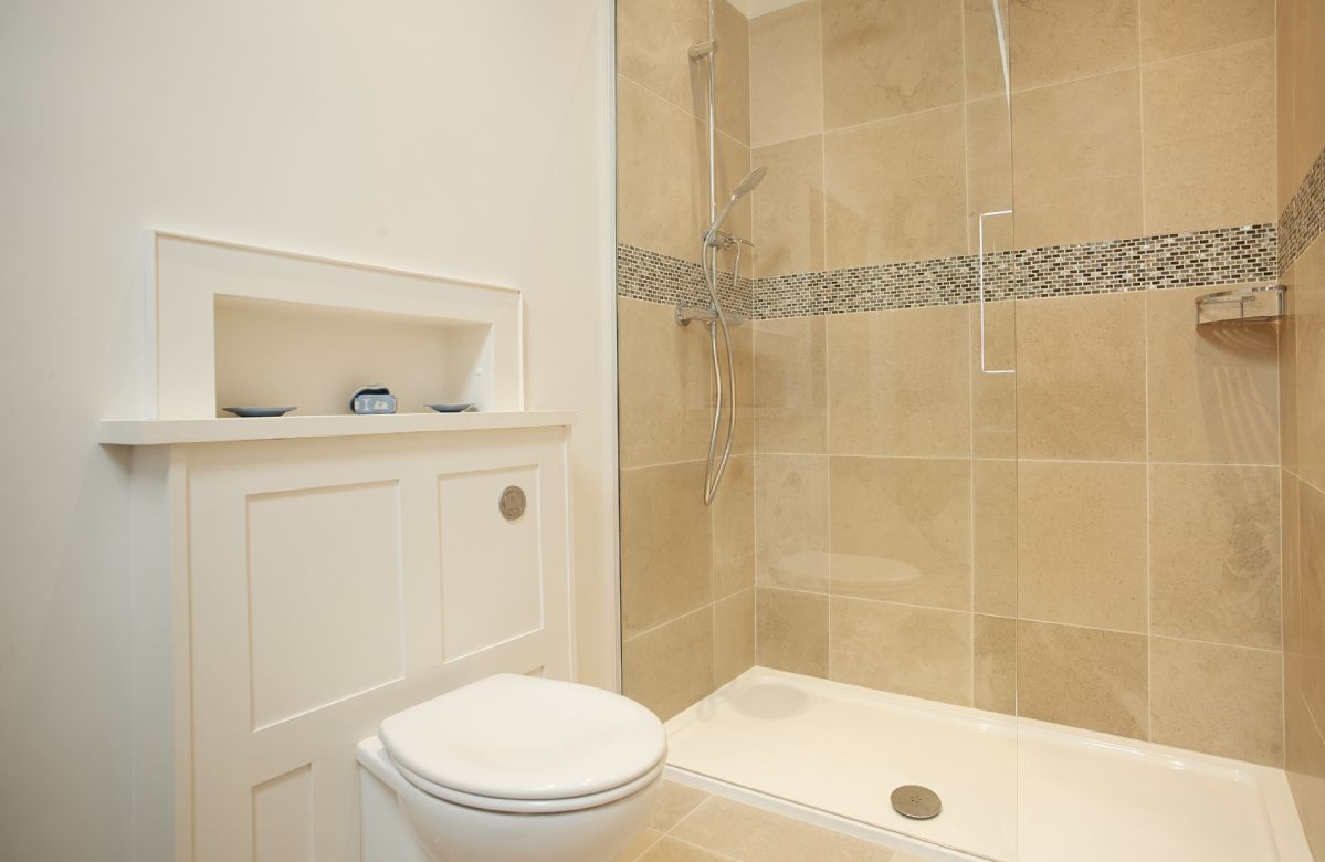 First floor: Croglin en-suite bathroom with bath and separate rainfall shower
