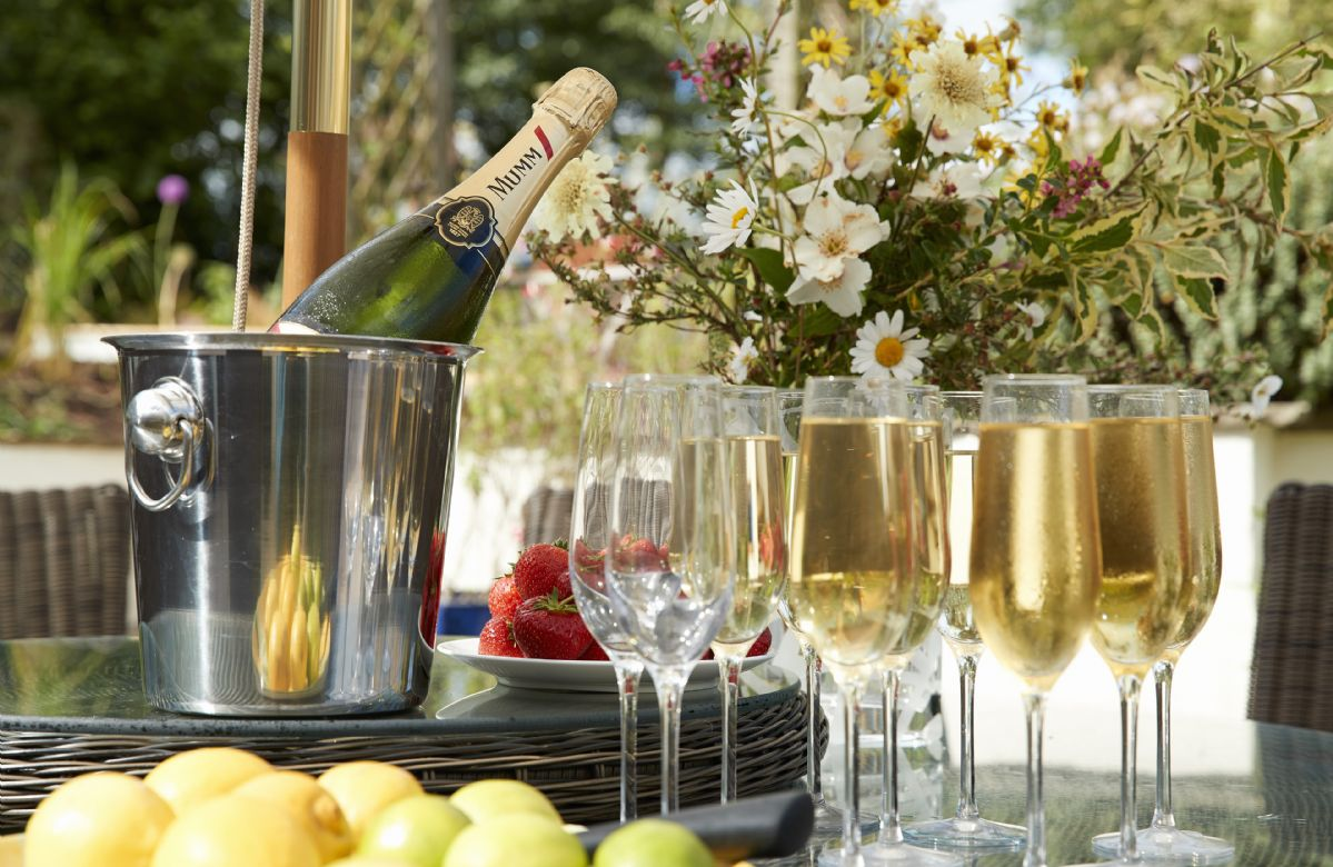 Enjoy a glass of fizz in the courtyard garden