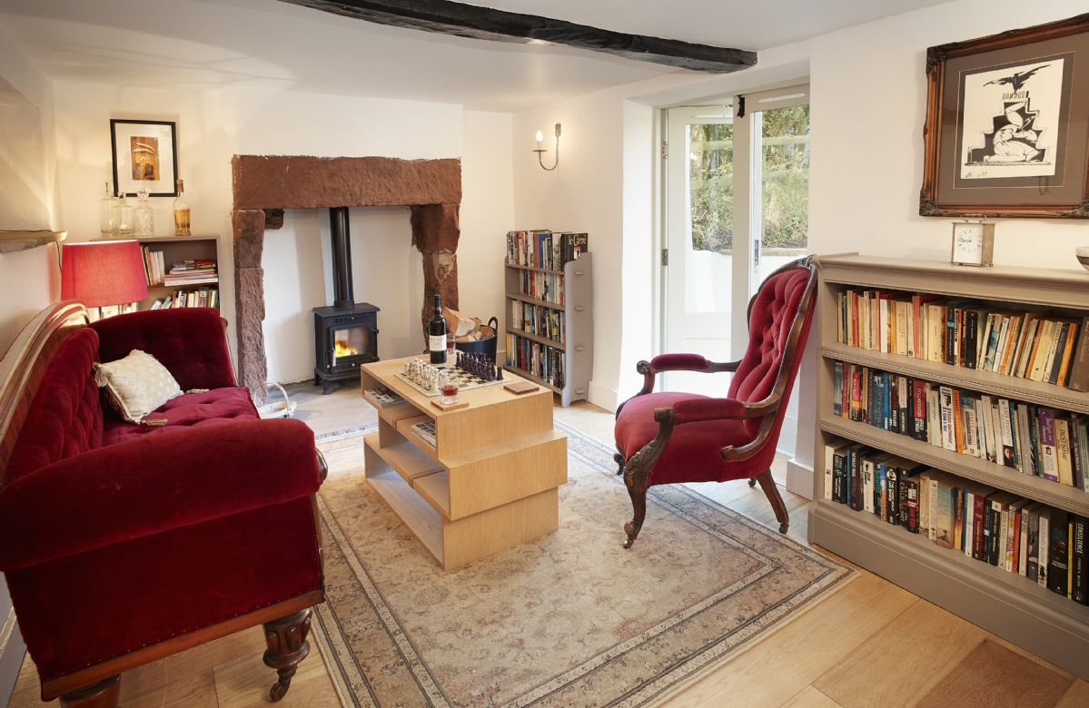 Ground floor: The cosy Library with wood burning stove