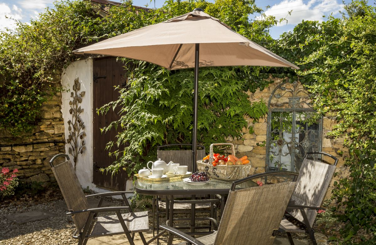 Alfresco entertaining in the fully enclosed patio garden to the rear