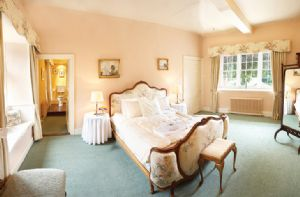 First floor: Master bedroom with 6' bed and en-suite bathroom with a built-in shower, roll-top bath and dressing area.The master bedroom is connected to the Jacobean Room which has 3' twin beds which can convert to 6' double which also has an en suite