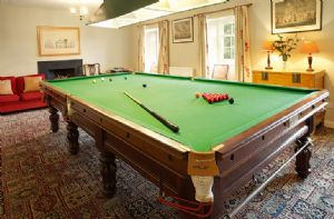 Second floor:  The billiards room has a full-size table and an open fire