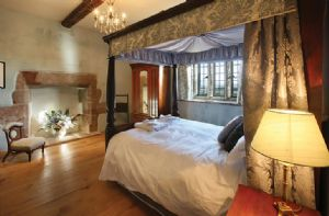 Second floor: Accessed by a spiral staircase leading to the North Tower: The North Tower Master Bedroom (5' four poster bed) with en suite bathroom with a separate shower and a vanity unit