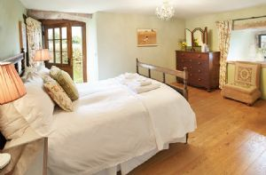Ground floor: The Garden Bedroom (5' double bed) has a private en suite with a wet room