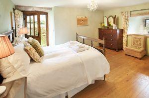 Ground floor: The Garden Bedroom (5' double bed) has a private en suite with a wet room
