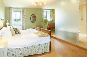 First floor: The West Range Master Bedroom (double 6' bed) with en suite walk through shower, freestanding roll top bath, separate cloakroom and double vanity unit