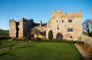 Blencowe Hall sits on a bluff above the small river Petteril and is encompassed by its own gardens