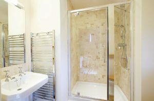 First floor: En-suite shower room to master double bedroom with 6' zip and link bed