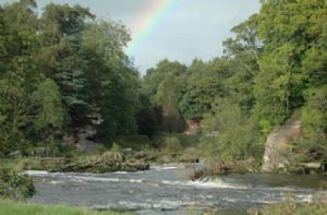 A view of Lacy's Caves across the Eden on the Rowley Estate, image courtesy of Cumbria Fly Fishing
