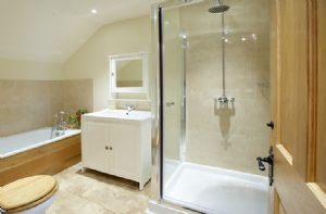 First floor: En-suite bathroom with bath and shower to double bedroom