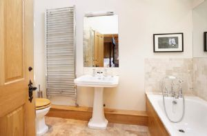 First floor: En-suite bathroom with separate shower to double bedroom with 5' four poster bed