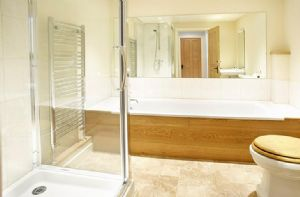 Ground floor: En-suite bathroom with a separate power shower to double bedroom with 5' bed
