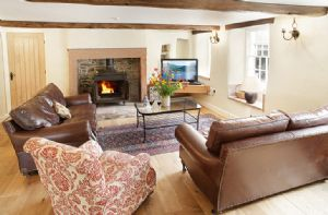 Hause Hall Farm, Ground floor:  Open plan sitting room with wood burning stove