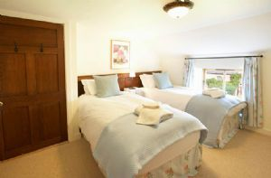 First floor:  Twin bedroom with 2' 10 beds