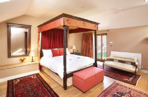 First floor: Master bedroom with 5' four poster bed with en-suite bathroom and separate shower