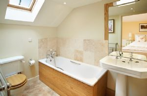 First floor: En-suite bathroom with a cast iron bath with shower on riser