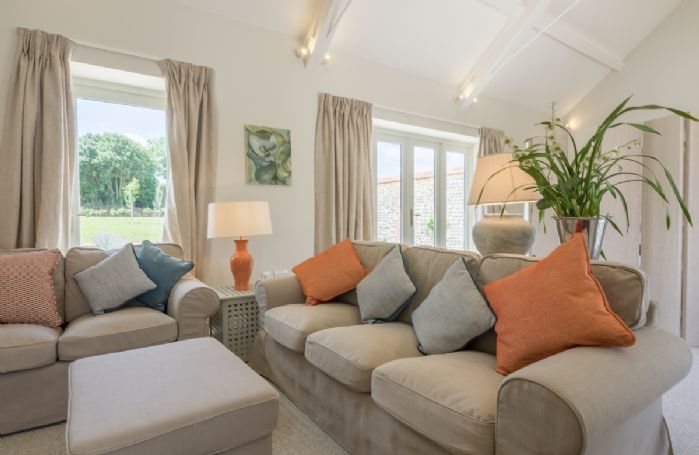 Along one 'wing' of the property is a very spacious sitting room with a folding screen at the far end of the room which conceals the 'bedroom area' beyond with a 6' Super King bed