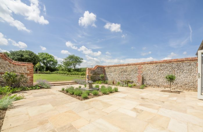 Two further courtyards offer a choice of seating areas