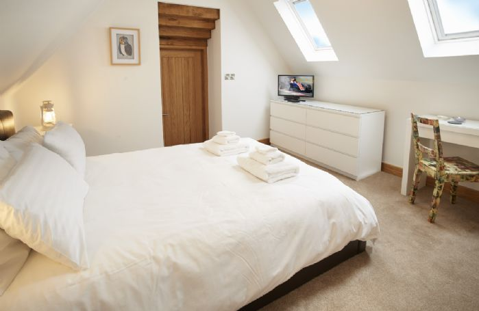First floor: Master bedroom with 5' Kingsize bed and en-suite bathroom