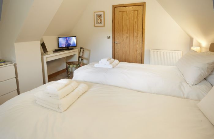 First floor: Twin bedroom with 2'6 single beds that can be converted to a 5' Kingsize double on request