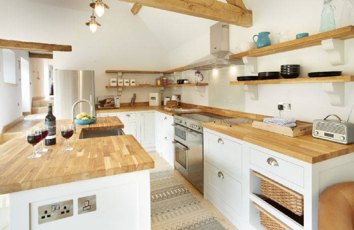 Rosebank Barn features a spacious vaulted ceiling oak beamed kitchen/diner that opens out onto a patio and garden through two large glazed bi-fold doors