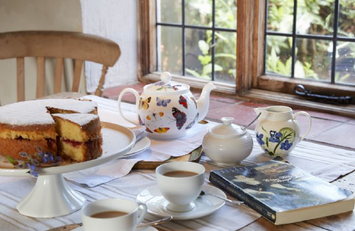 Enjoy afternoon tea looking out on to the beautiful gardens