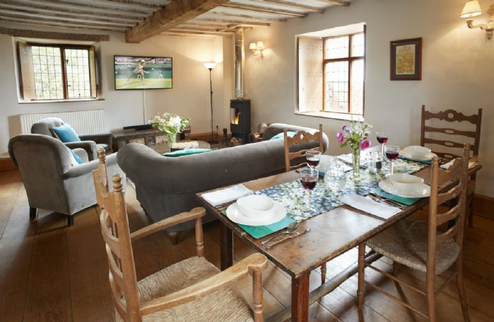 First floor: Open plan sitting room with wood burning stove, kitchen and dining area with large dining table seating four