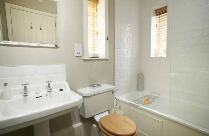 Ground floor:  Bathroom with shower over bath