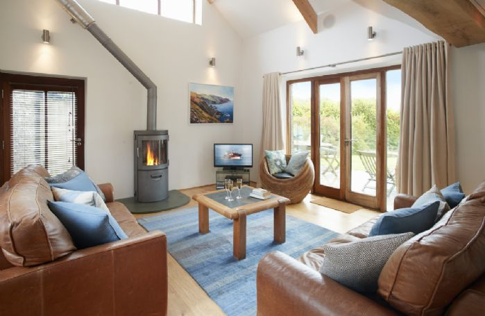 Ground floor: Double height sitting room with wood burning stove