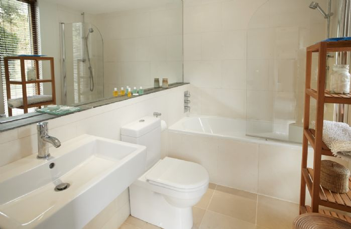 Ground floor: Bathroom with power shower over bath