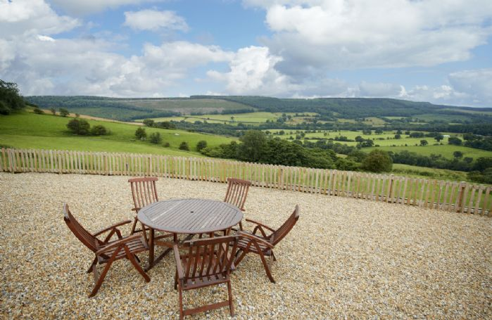 Fully enclosed garden with garden furniture