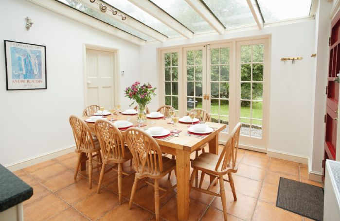 Lower ground floor:  Garden room for dining off kitchen with French doors to garden
