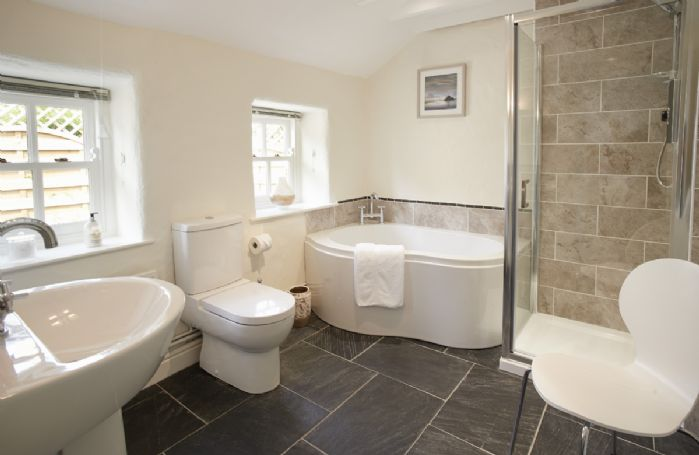 Ground floor: Bathroom with bath and separate walk in shower