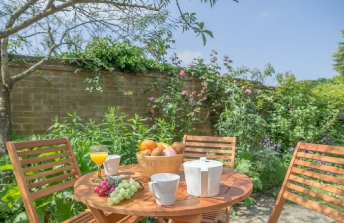 The garden is the perfect spot to enjoy breakfast in the sunshine